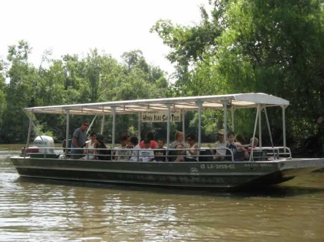 Flat-bottom tour boat in the Honey Island swamp in Louisiana